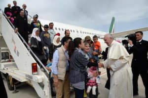 Pope welcomes refugees on board plane
