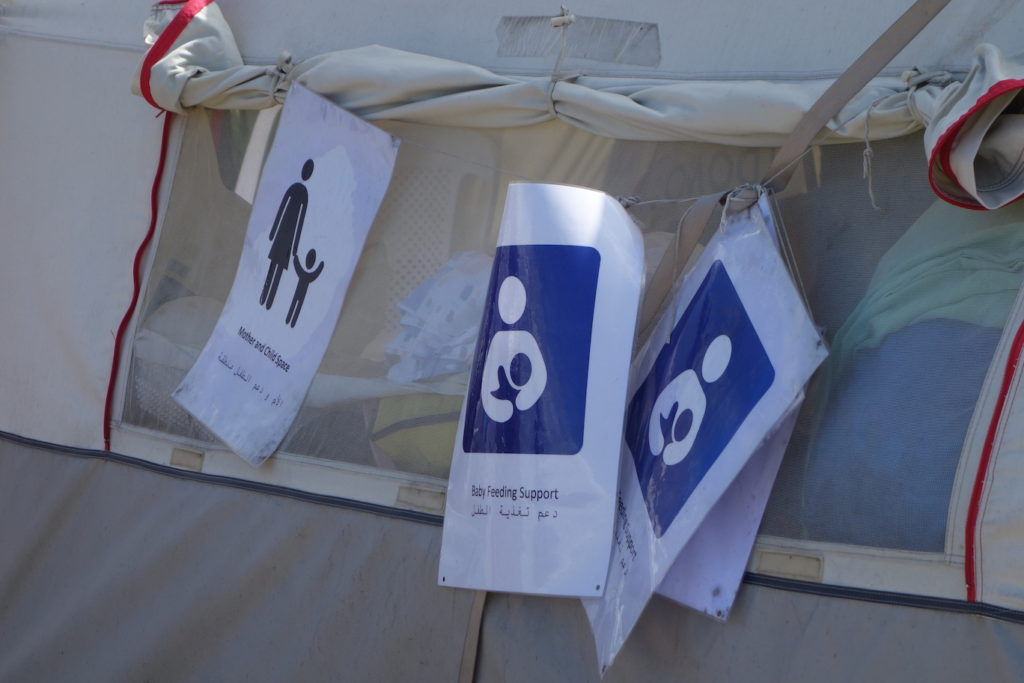 Signs hanging from a tent in the 'wild' camp at the Eko Gas station in Greece near the Macadonian border - Sarah Moore