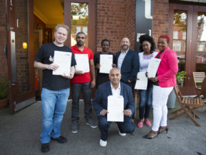 Global Kitchen awards Mark with trainees