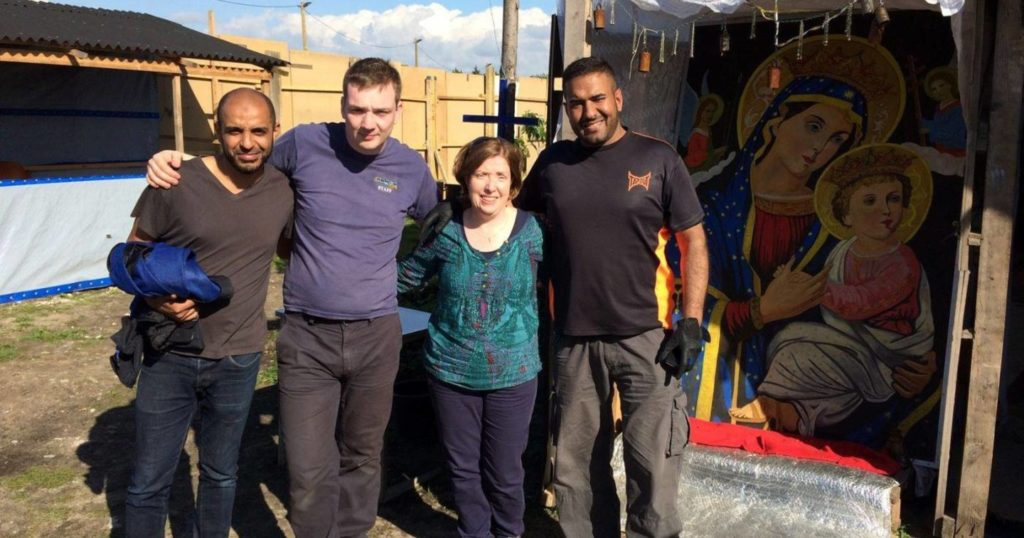 Moira church team in Calais - Iain and Diane with volunteers in the Calais Jungle camp
